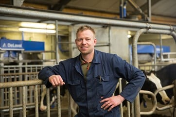 14. DeLaval VMS milking system V300 with farmer.jpg